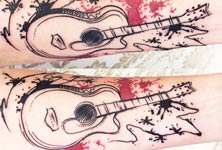 Guitar tattoo by Bambi Tattoo