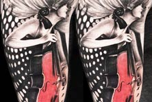 Woman musician tattoo by Ivan Trapiani